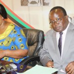 FILE: Information and Broadcasting Minister Dora Siliya addresses journalists as her acting permanent secretary Isaac Chipampe, who is now State House press aide, listens at her office on May 23, 2018 - Picture by Tenson Mkhala