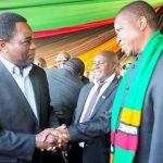 President Edgar Lungu and his rival Hakainde Hichilema shake hands during veteran politician Daniel Munkombwe's burial