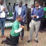 Miles Sampa kneels before President Edgar Lungu to show gratitude for forgiving him at a public rally in Matero on July 12, 2018