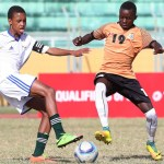 Kananelo Rapuleng of Lesotho tackles Vincent Kalinda of Zambia during the 2018 Cosafa Under 17 Youth Championships football match between Zambia and Lesotho at the Anjalay Stadium, Mauritius on 22 July 2018 ©Gavin Barker/BackpagePix
