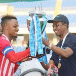 President Edgar Lungu hands over the 2018 Barclays trophy to Nkana's Skipper Walter Bwalya after beating Young Buffaloes team 3-0 on November 10, 2018 – Picture by Tenson Mkhala