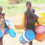 Jane and her young sister walk a kilometer in search of drinking water in Muselepeta area of Kasempa District in North Western Province on December 8, 2018 – Picture by Tenson Mkhala