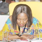 Finance Minister Margaret Mwanakatwe follows proceedings of the Dialogue Forum on May 13, 2019