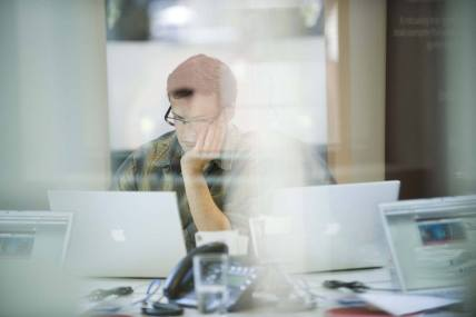 man looking on a laptop screen