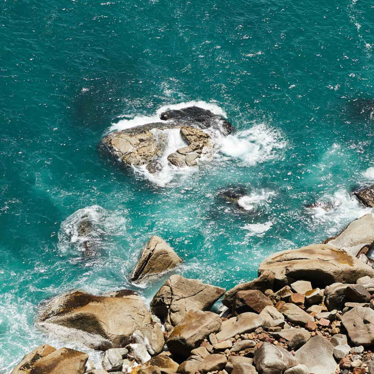 sea water splashing on stony coast