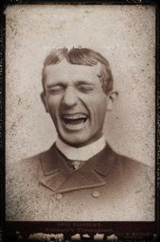 Vintage black & white image of a Victorian man laughing. Source unknown.