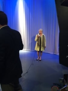 Woman presenting at a video social and mobile lunch recap for corporate recruitment videos.