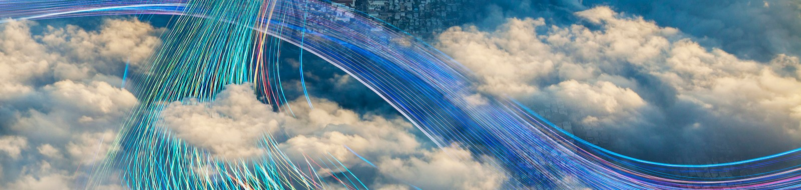 Fiber optic cables crossing in cloudy sky over city