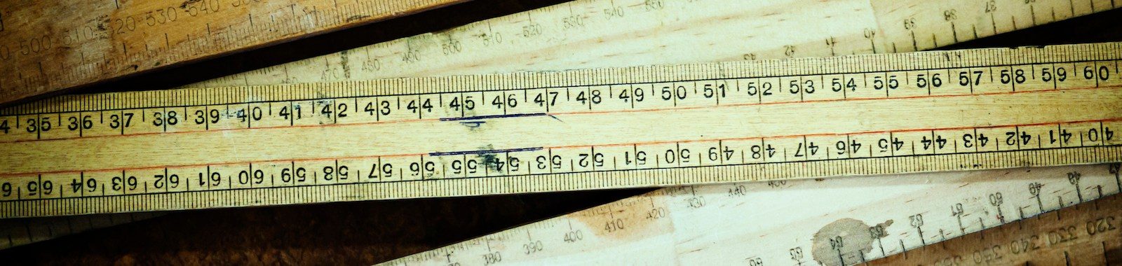 Wooden meter rules lying on ground.