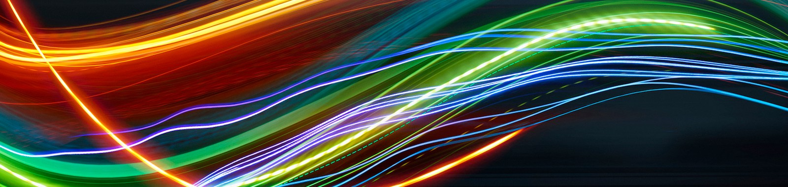 Blurred light trails against blurred black background