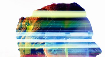 Multiple exposure of a young woman combined with traffic light trails from a long exposure, taken in London on Vauxhall Bridge at night.