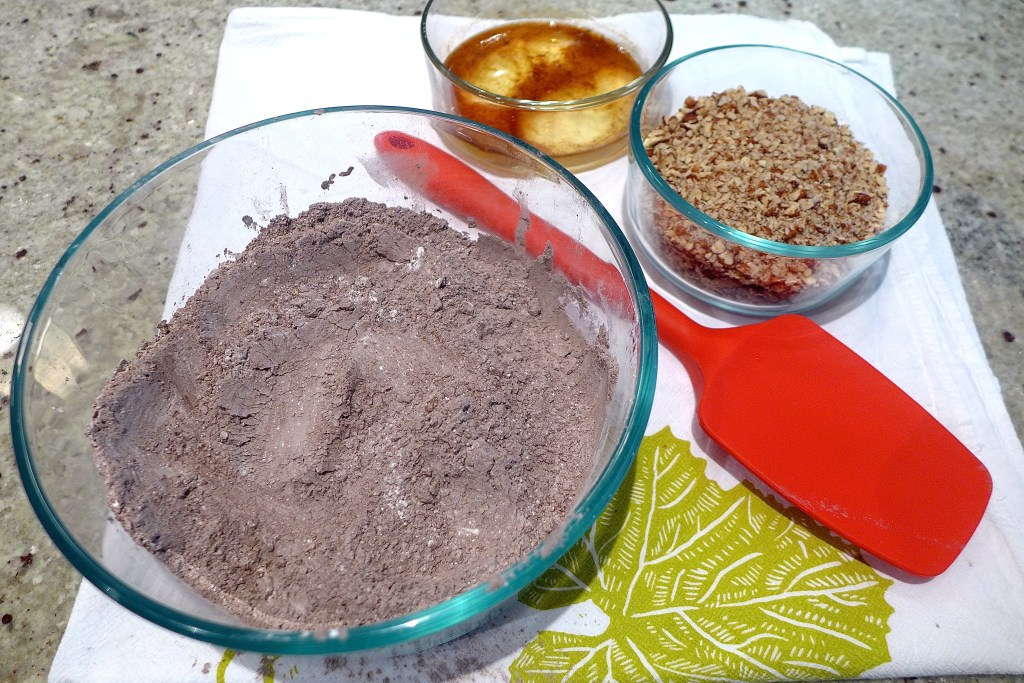 Combine dry ingredients. Add nuts, then eggs and vanilla.