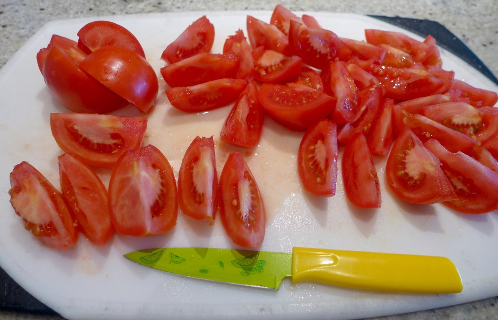 Slice each tomato into eight wedges. Save extras for salad or decoration.
