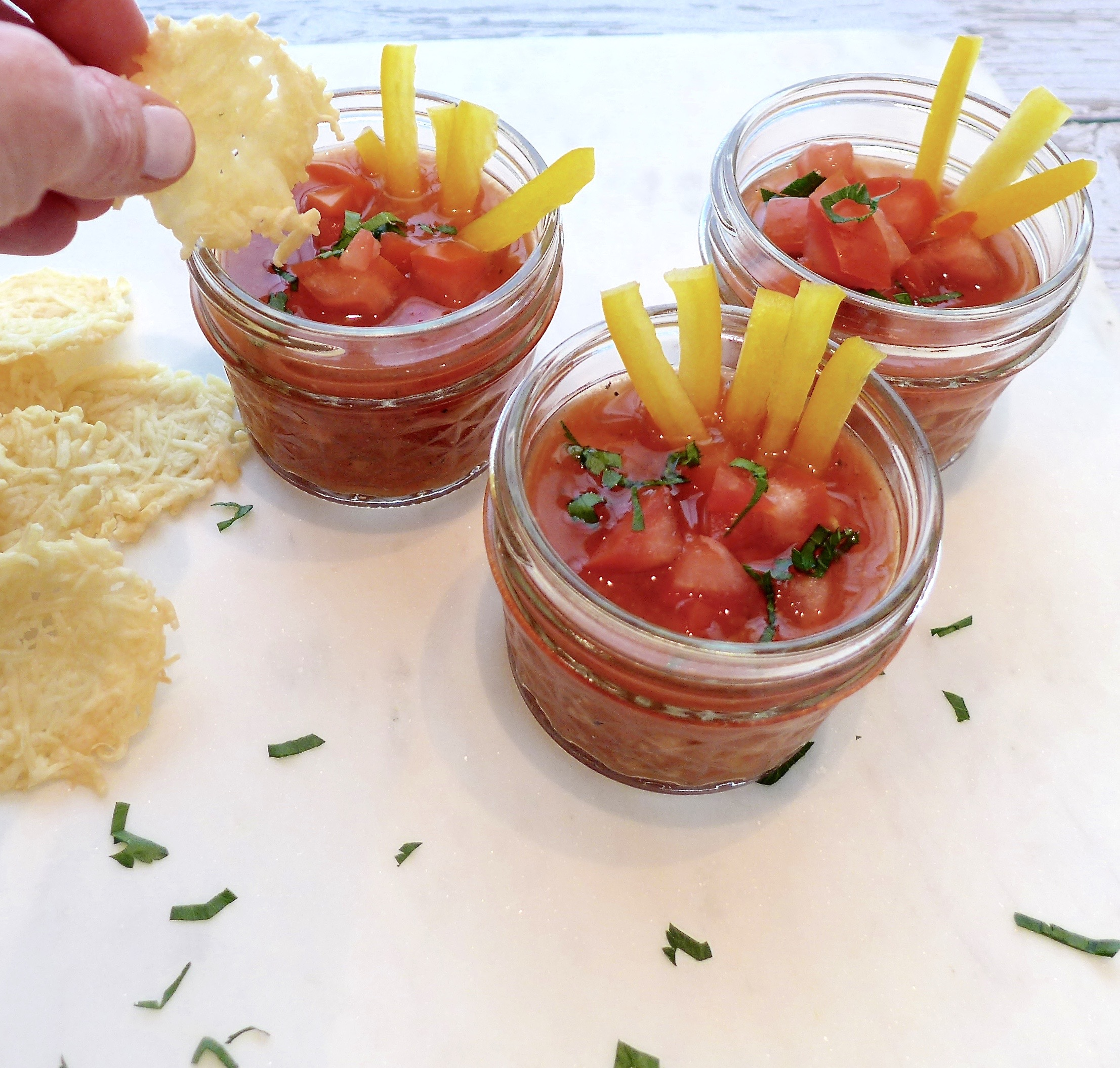 Serve gazpacho in little jelly jars or small glasses for a great starter, side or party sipper. Use Parmesan crisps for dippers or dig in with a spoon!