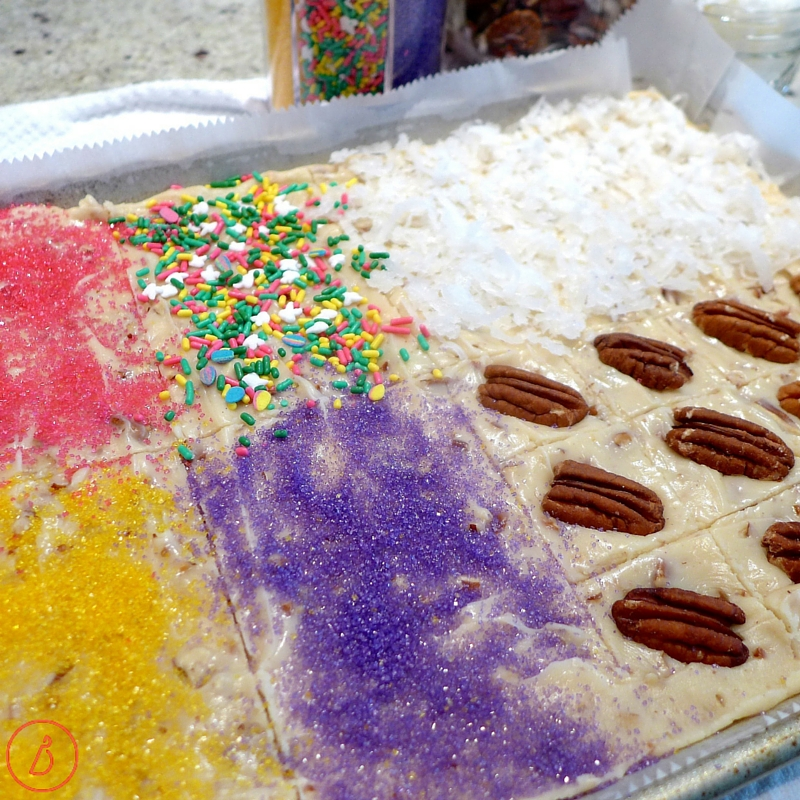 Use the tip of your knife to divide fudge into quadrants and decorate with different toppings.