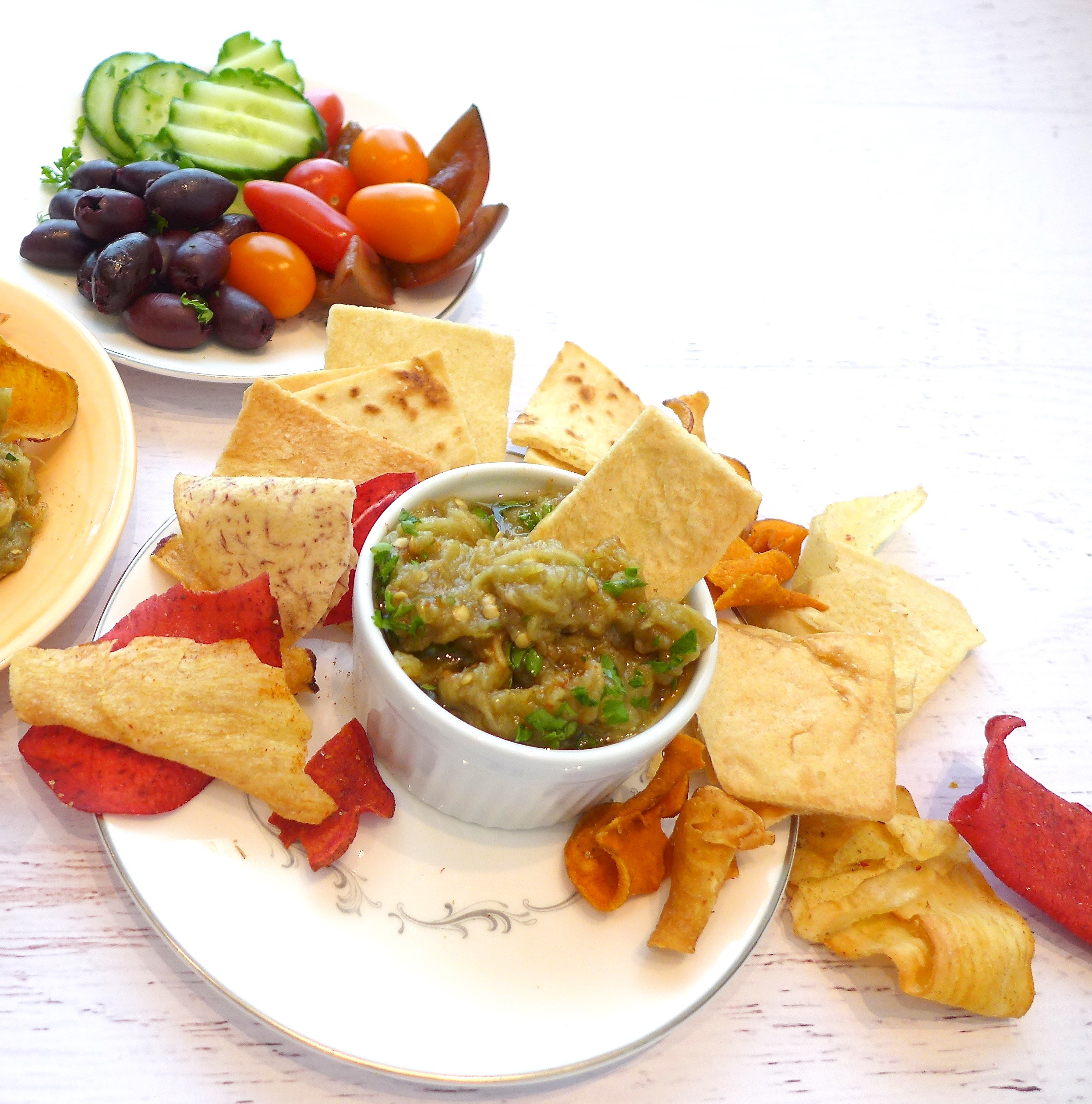Serve Mediterranean Eggplant Dip with Pita and vegetable chips and raw veggies.