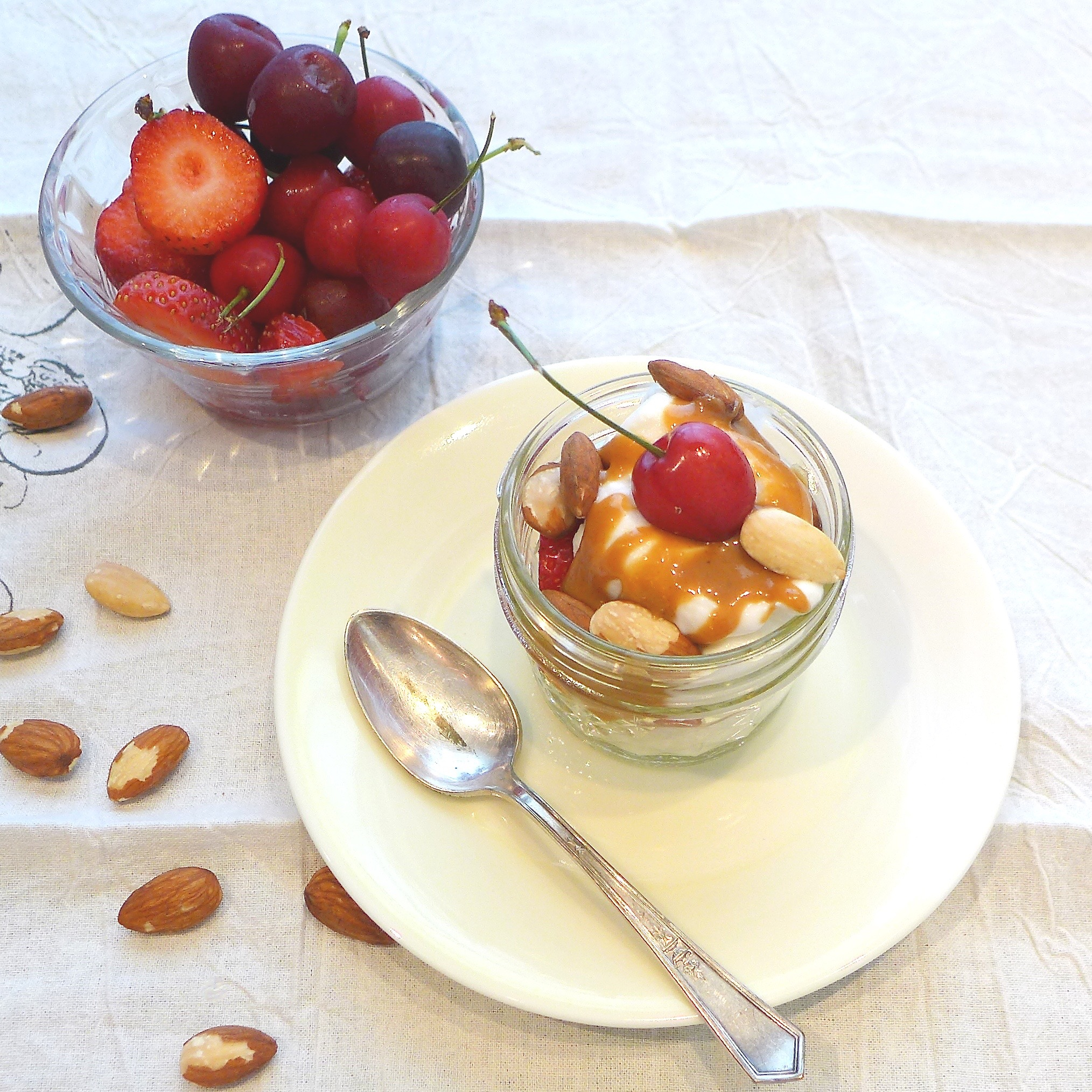 Fruit and Yogurt Parfait with nut butter drizzle and almonds