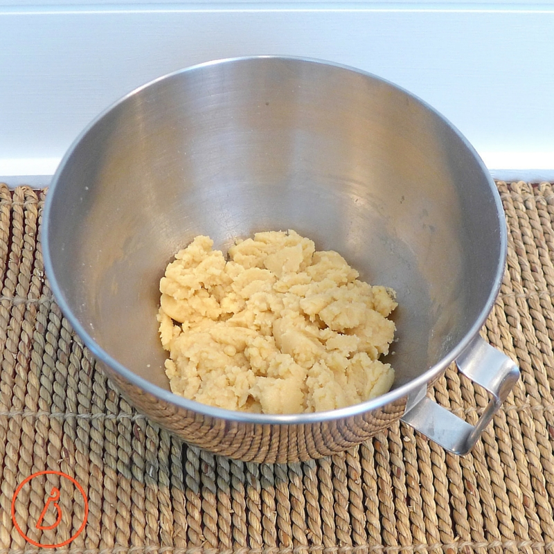 Add melted butter to sugar, flour and flavorings and mix just until blended. Don't over mix! Taste and add a little more salt if you like.