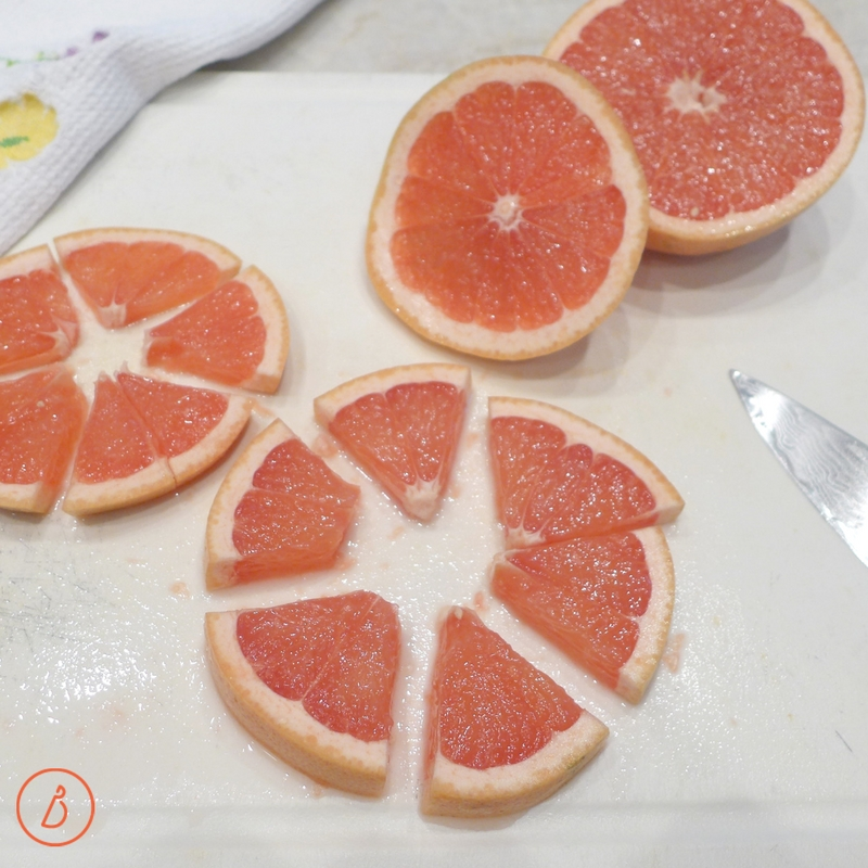 Slice grapefruit into wedges for Simple Ruby Margaritas. Recipe and ideas at diginwithdana.com