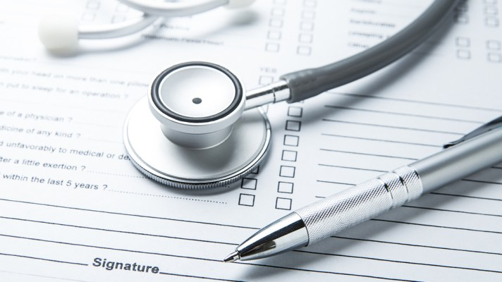 doctor's instruments on a document