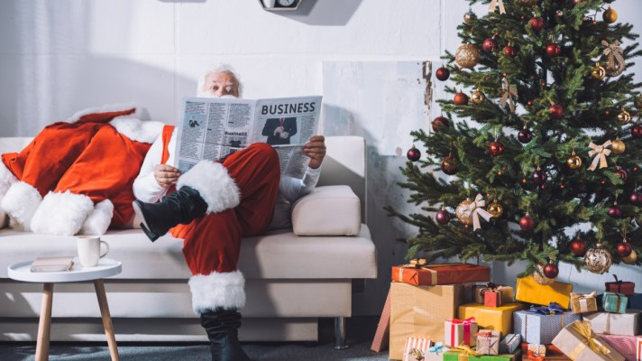 Santa reading the business news