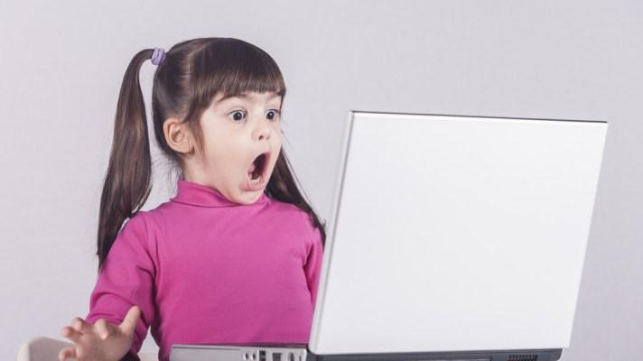 child using a laptop / child online safety