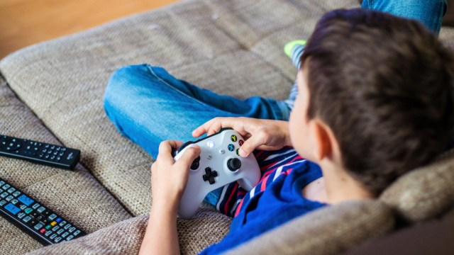 child playing with an Xbox One