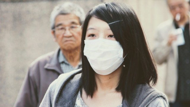 Chinese woman wearing virus protection mask