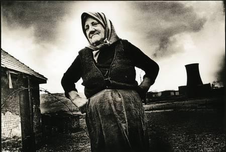 farmer`s wife in front of power plant by Hans-Joachim Herr