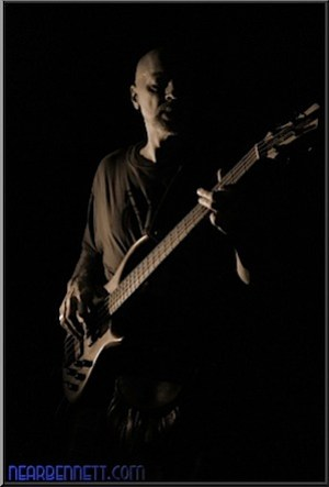 Bass player lit with off camera flash