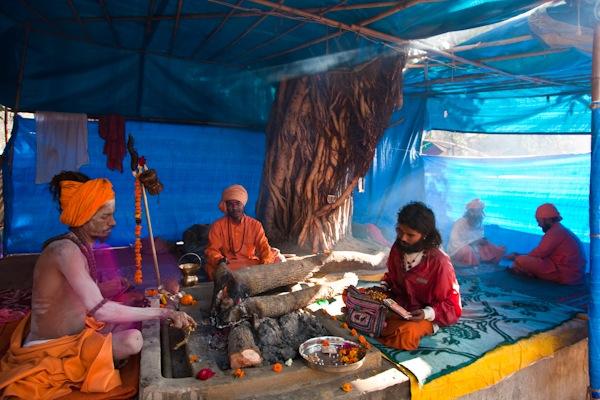 Image: Naga Sadhu stokes the fire: Haridwar, India