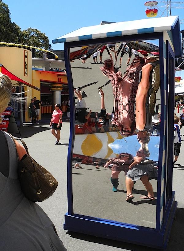 People in distorting mirror.JPG