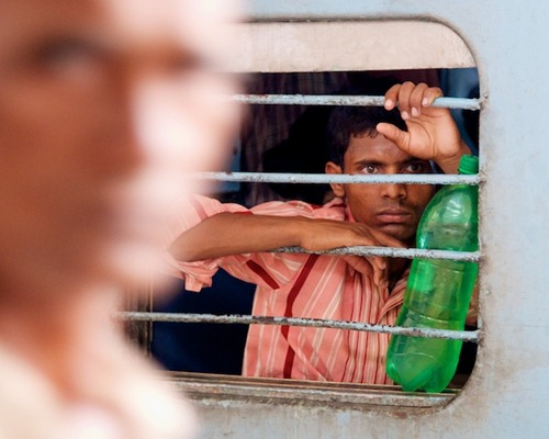 2. Waiting on a Train - Old Delhi, India - Copyright 2011 Ralph Velasco