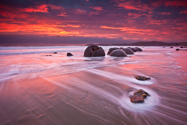 Image: Sunrise Over The Moeraki Boulders, Otago New Zealand. Seascapes lend themselves to the creati...