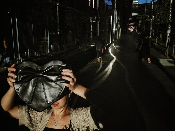 Image: Hiding from the light, Market St, Sydney