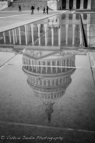 Photographing a reflection of a famous landmark such as the US Capitol in DC was a good way to avoid the cliché shot that every other tourist snaps daily. Adding the human element adds a sense of scale.
