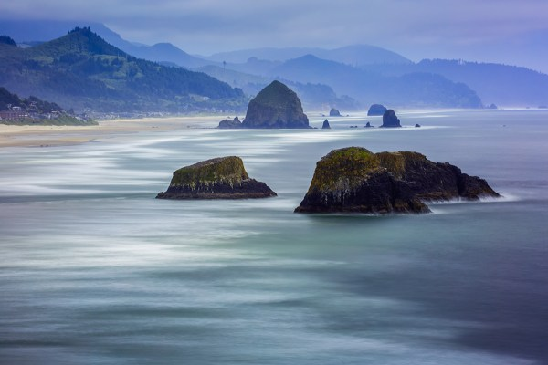 From Ecola State Park, you can view the vast expanse of Cannon Beach below.  EOS 5D Mark III, EF 70-300 f/4-5.6L IS, with a 5-stop and 6-stop ND filter stacked together to create the long exposure. 30 seconds, f/25, ISO 160.