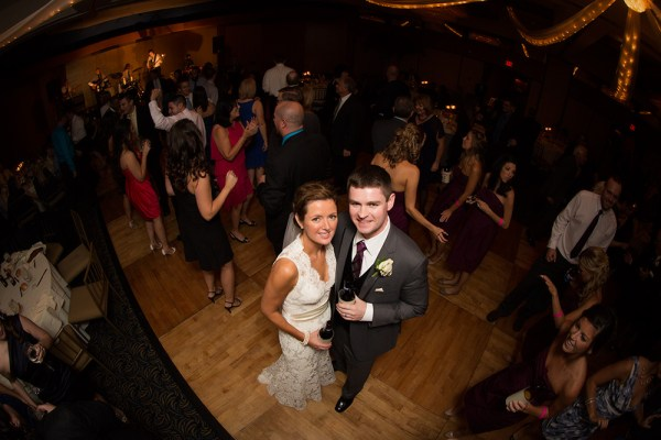 A fisheye lens has become a staple in my bag for shooting weddings. I've found it useful in the church for taking an overall scene, as well as on the dance floor for shots like this, of the bride and groom surrounded by their guests. Simply pop the flash at the same time and put them in the spotlight.