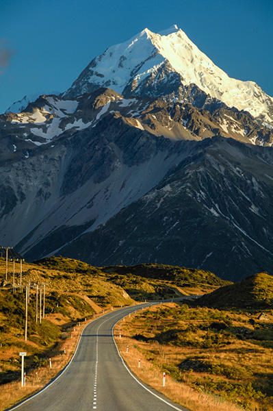 The road to Mount Cook New Zealand.  Nikon D7000, Nikkor 70-200mm f/2.8 Vrii, Marumi Polarizer. 135 mm (202mm 35mm equivalent), f/11, 1/15h, ISO100. The vertical aspect exaggerates the effects of telephoto compression in scenes like this.