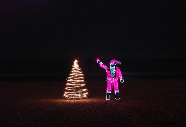 Santa hangs the star
