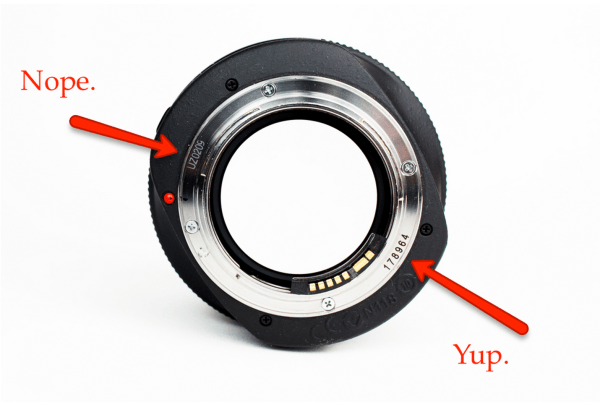 Not every number on your lens is a serial. Be sure you are reading the right thing.