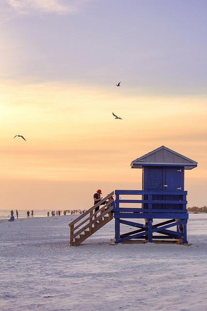 lifeguard at sunset