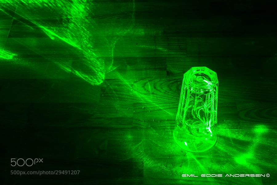 Photograph Laser through a glass  by Emil Eddie Andersen on 500px