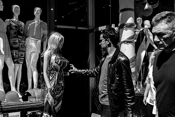 This mannequin was the perfect opportunity for a fun shot. During my NYC street photographer workshop, one of my students managed to capture this shot. She found her stage, envisioned the shot, was prepared and grabbed the opportunity when the right subject entered the frame. Well done Yevette! ©Yevette Handler