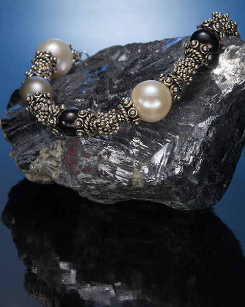 jewelry product shot using a gelled strobe and light panel
