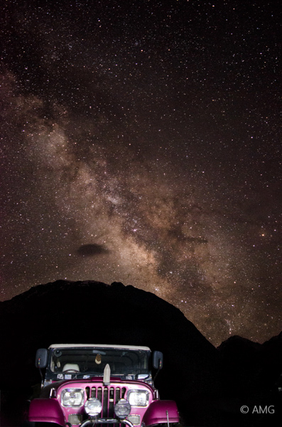 star photography with a car in the foreground