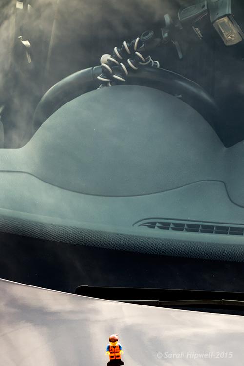 Emmet-on-car-flash-on-wheel