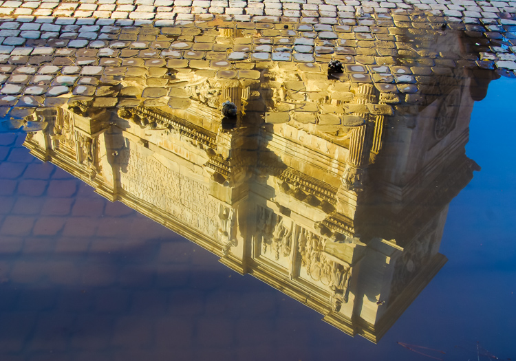 Rome - reflection of building in a puddle