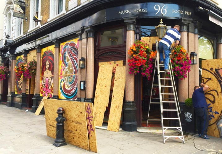 Every year Europe's biggest street party comes to the streets of West London, which means all of the shops and homes are boarded up. This photo sold within a few hours of being live.