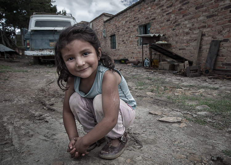 wide-angle portrait of girl in the dirt